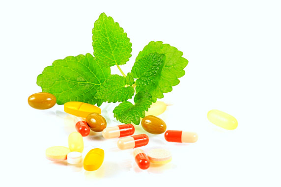 pills and tablets with a leaf